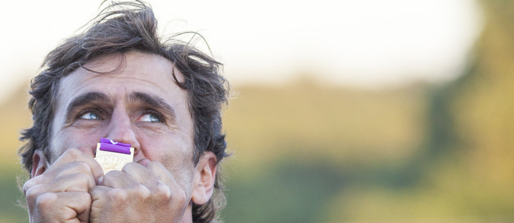 Alex Zanardi react at the medal ceremony  after he wins the race